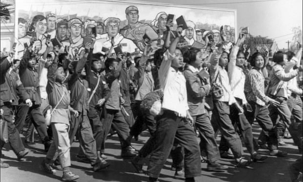 Red Guards and students, waving copies of Mao's Little Red Book, parade in Beijing at the beginning of the Cultural Revolution.