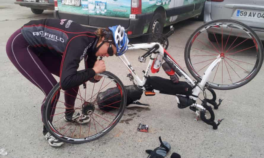 Juliana Buhring repairing her bike on the road in Turkey.