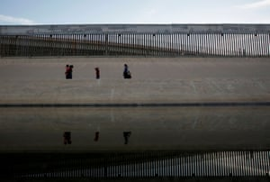El Paso, TexasMigrants walk along the banks of the Rio Bravo after crossing illegally into the US, ready to turn themselves in to request asylum in El Paso, Texas.