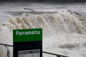The Parramatta River breaks its banks at the Charles Street weir and ferry wharf in Parramatta