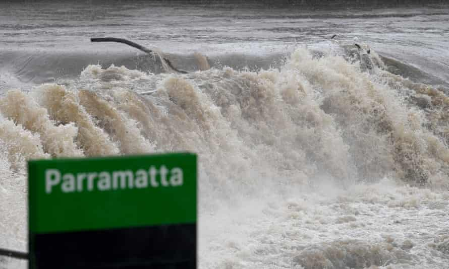 The Parramatta River breaks its banks at the Charles Street weir and ferry wharf