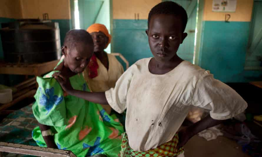 A girl with her mother, who has Aids, in a hospital in Uganda