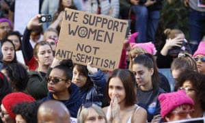 """A demonstrators holds a sign against """"Anti-Semitism"""" as she joins the Women's March in Los Angeles on Saturday, Jan. 19, 2019. (AP Photo/Damian Dovarganes)"""