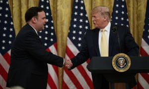 Donald Trump shakes hands with White House social media director Dan Scavino during a social media summit at the White House.