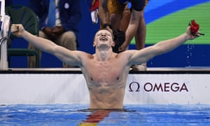 Britain's Adam Peaty celebrates after winning gold in the 100m breaststroke.