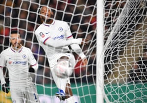 Batshuayi celebrates by kicking the ball into the net.