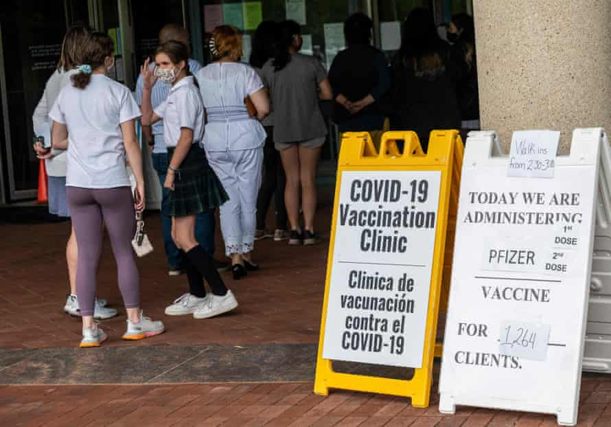People arrive to receive Covid-19 vaccinations at a vaccination clinic in Fairfax, Virginia.
