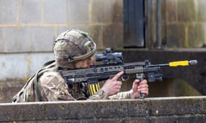 A soldier carries out a military exercise at the army training base.