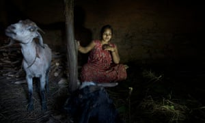 Laxmi Tamatta, aged 20, sits in a chhaupadi shed in Acham district, Nepal