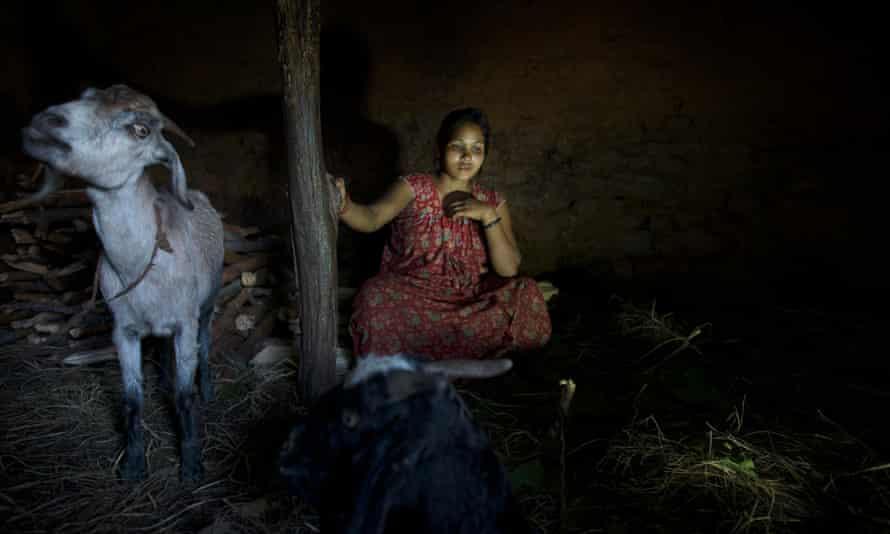 Laxmi Tamatta, aged 20, sits in a chhaupadi shed in Acham district, Nepal