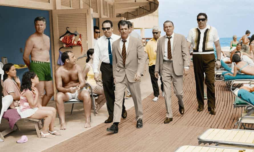 Frank Sinatra with his minders and stand-in, who is wearing an identical outfit to the singer and actor, in Miami Beach while filming The Lady in Cement in 1968.