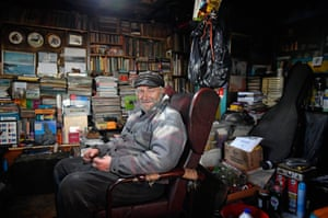 Crofter Eric Ibister, 78, sits in his armchair at his home in Hametoun
