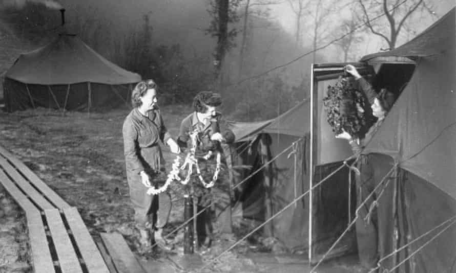 Members of the Women's Army Corps decorate their tent on the Italian front in the Appennine mountains, December 1944.