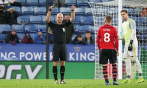 Referee Roger East consults VAR before disallowing a goal for Southampton in their Carabao Cup tie at Leicester earlier this season.