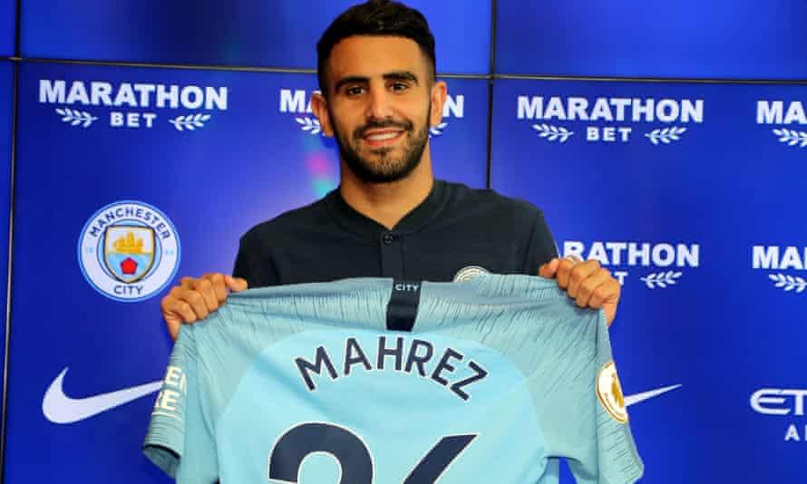 Riyad Mahrez, Manchester City's £60m signing, holds up his No26 shirt.