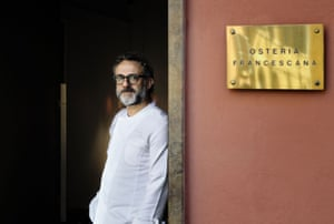 Italian Chef Massimo Bottura poses at the entrance of his restaurant, Osteria Francescana, in Modena