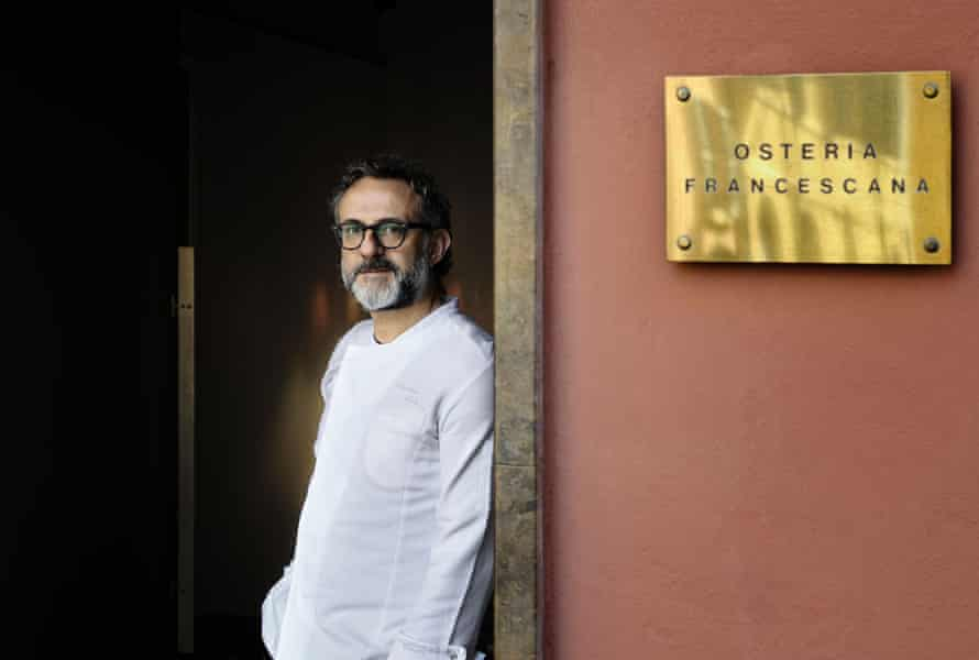 Italian Chef Massimo Bottura poses at the entrance of his restaurant, Osteria Francescana, in Modena