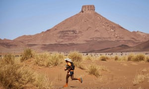 A competitor traversing the Moroccan Sahara desert during the 257km Marathon des Sables.