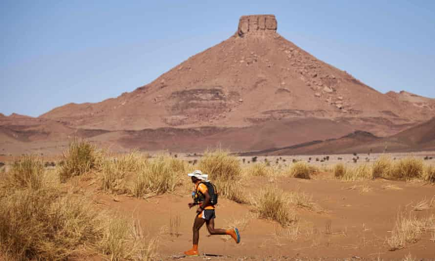 A competitor traversing the Moroccan Sahara desert during the 257km Marathon des Sables.