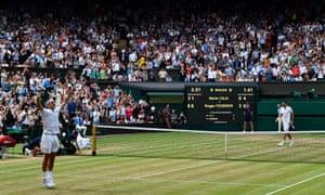 Roger Federer celebrates after winning against Marin Cilic.