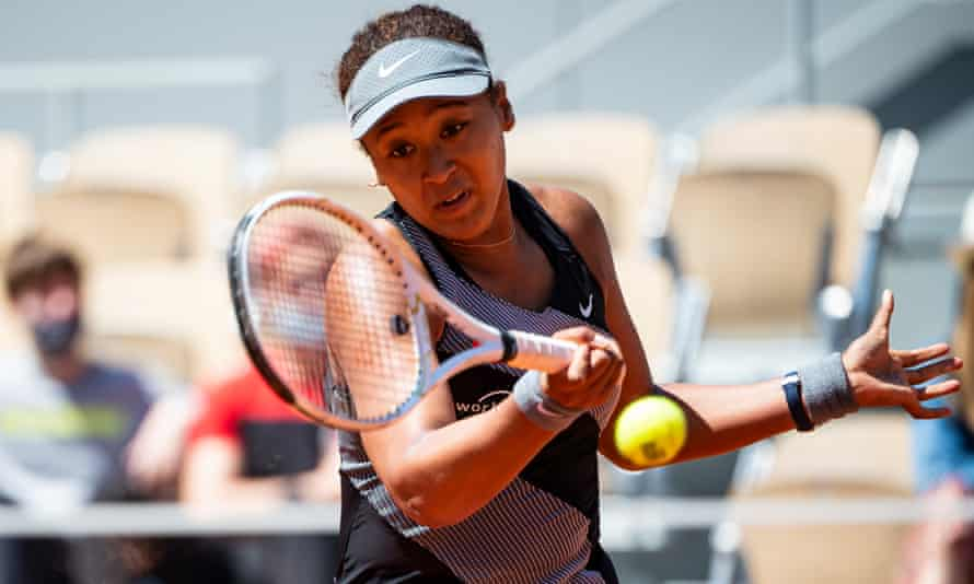 Naomi Osaka hits a forehand against Patricia Maria Țig in the first round of the French Open.