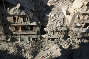 People dig in the rubble in a search for survivors after an airstrike