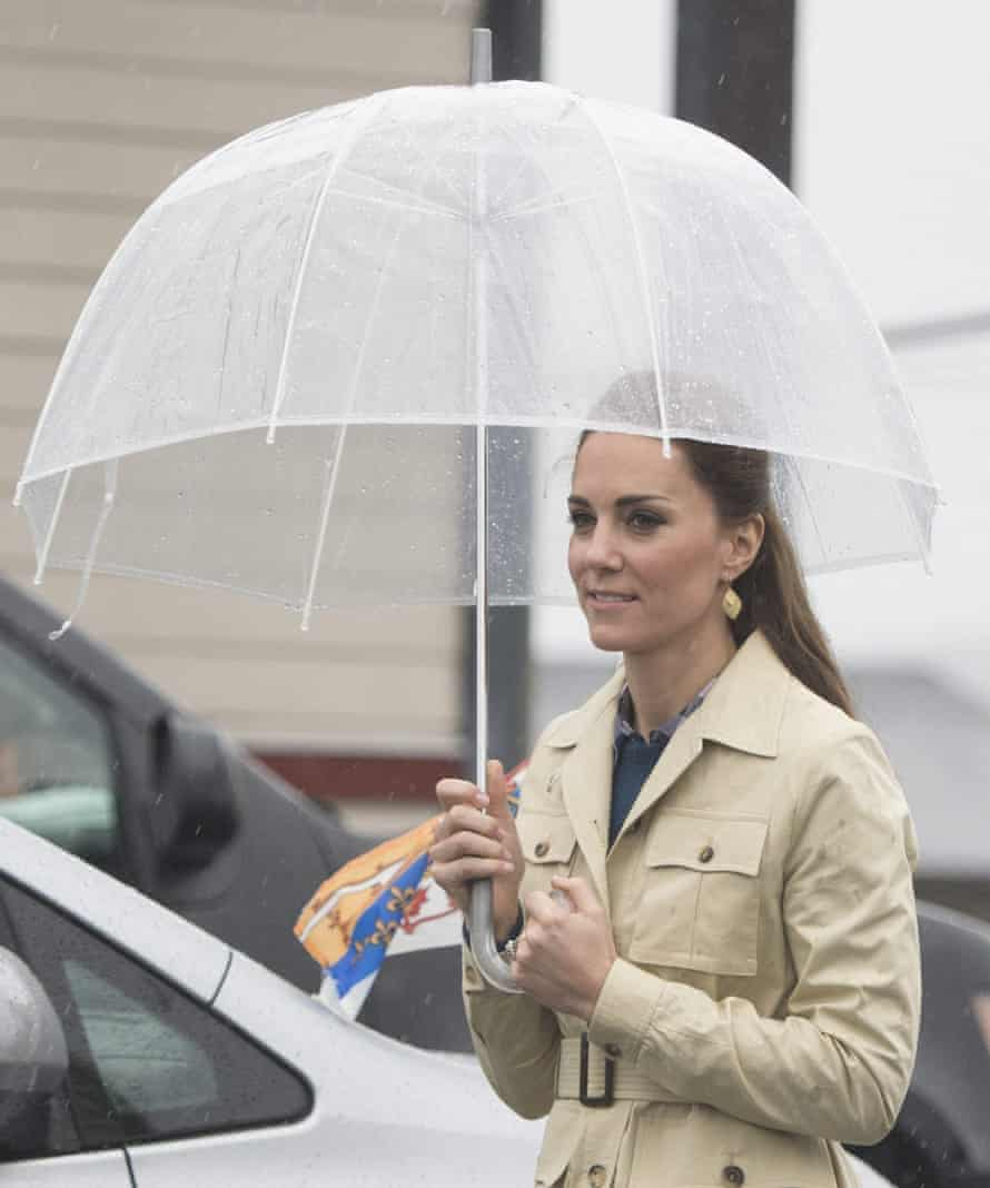 The Duchess of Cambridge in a trench coat while on the Canadian tour.