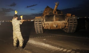A Turkish army tank on the border with Syria. Forces are expected to move into Kurdish-held areas ???shortly???.
