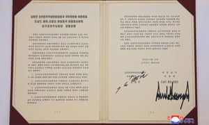 A photo released by the official North Korean Central News Agency (KCNA) shows the agreement signed by Korean leader Kim Jong-un and US president Donald Trump in Singapore on Tuesday.