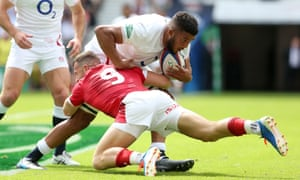 Lewis Ludlam is tackled by Gareth Davies of Wales on his Test debut