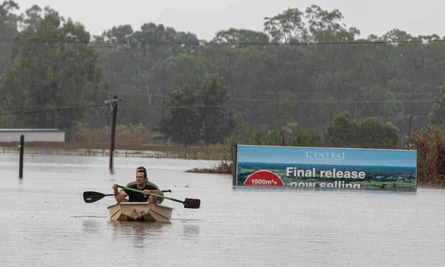 A sign announcing the final launch of new homes in Pitt Town submerged in flood waters