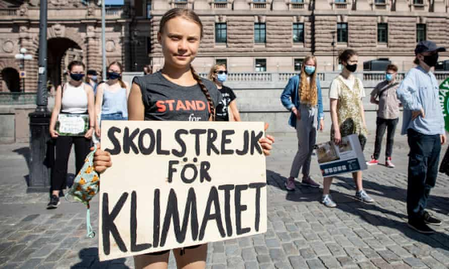 Greta Thunberg and other protesters during their School Strike for Climate in front of the Swedish parliament building.
