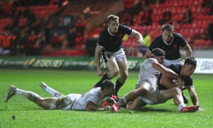 Wales' Louis Rees-Zammit (right) is tackled on the line by Georgia's Sandro Todua.