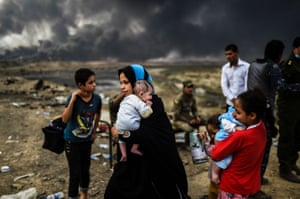 Qayyarah, IraqFamilies displaced by the ongoing operation by Iraqi and Kurdish forces against Isis fighters in and around Mosul wait near the town of Qayyarah, 18 miles south of Iraq's second-largest city