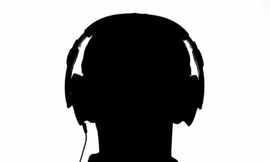 silhouette of man with headphones