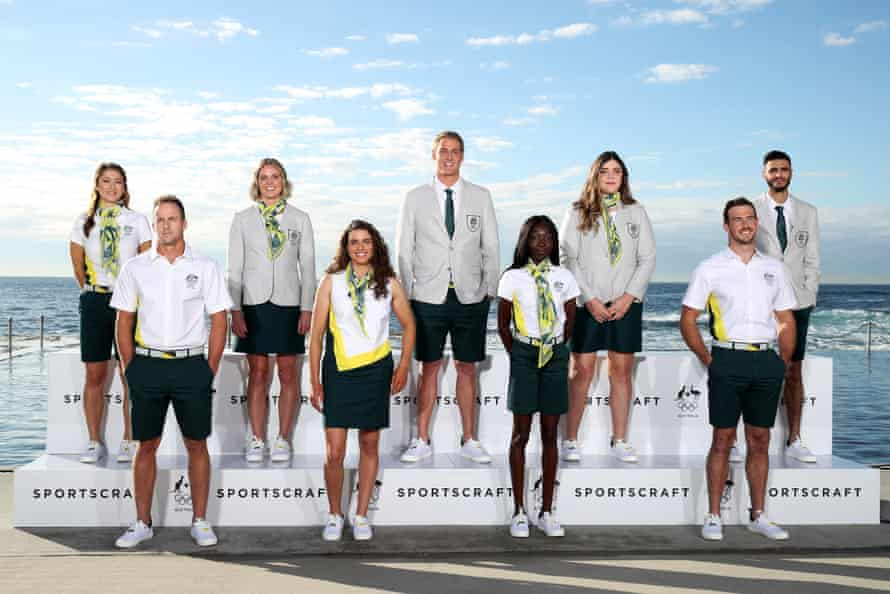 Australian athletes Gronya Somerville, Lachlan Tame, Keesja Gofers, Jessica Fox, George Ford, Bendere Oboya, Tarni Stepto, Dan Watkins and Safwan Khalil model their uniforms for the 2020 Tokyo Olympic Games opening ceremony