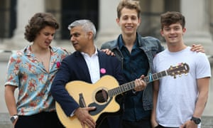 "Sadiq Khan poses with Brad Simpson ( far left), James McVey and Connor Ball (far right), members of the British band ""The Vamps"", to mark International Busking Day in London last week."