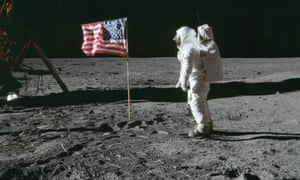 Astronaut Edwin E Aldrin poses for a photo beside the US flag that has been placed on the moon during the Apollo 11 mission, 21 July 1969.