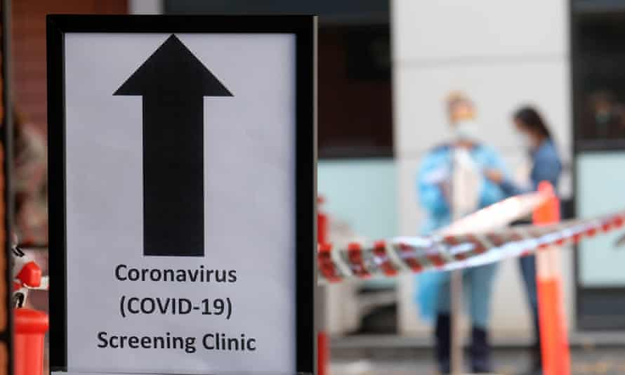 A sign directing people to the coronavirus screening area at Royal Melbourne hospital