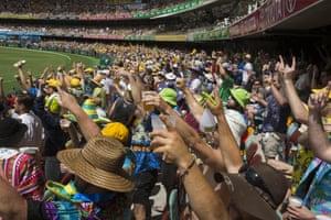 Australian fans celebrate Smith's century.