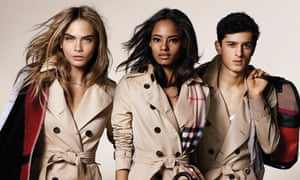 Burberry's trademark macs modelled by Cara Delevingne, Malaika Firth and Tarun Nijjer (alligator version not pictured).