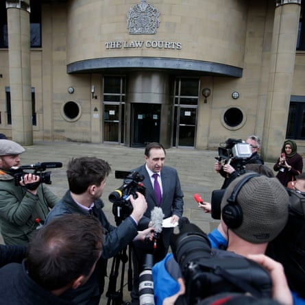Gerry Wareham, CPS chief crown prosecutor for the north-east, reads a statement outside Bradford Crown Court.