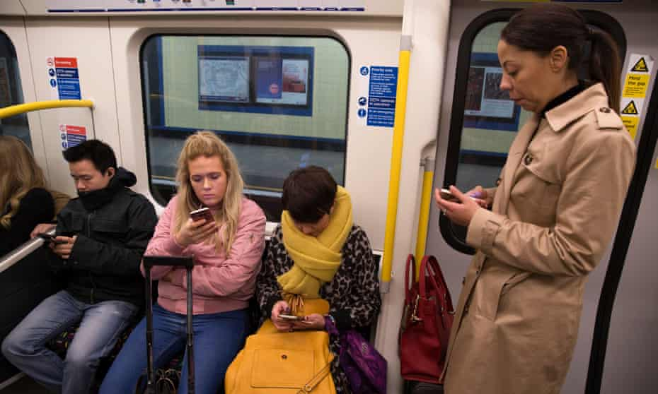 Commuters on the London underground: Boyne's 'targets are the smartphone-addicted, the click-obsessed'.
