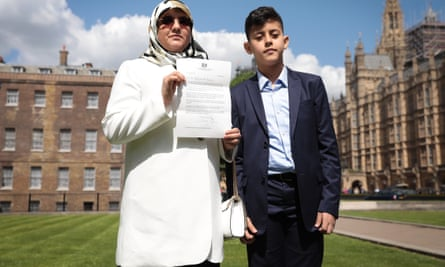 Fatima Boudchar, outside parliament with her son Abderrahim Belhaj, was tortured after she and her husband were rendered to Libya.