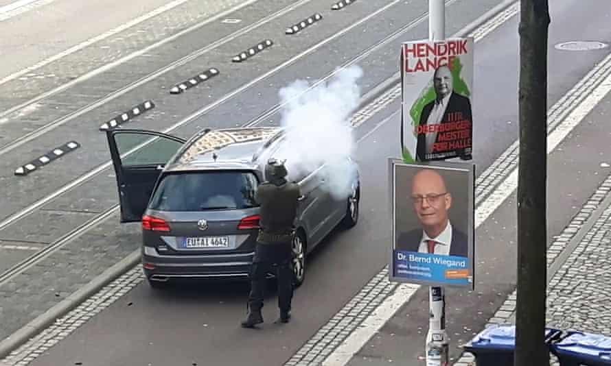 A screenshot of a video shows the gunman firing a weapon.