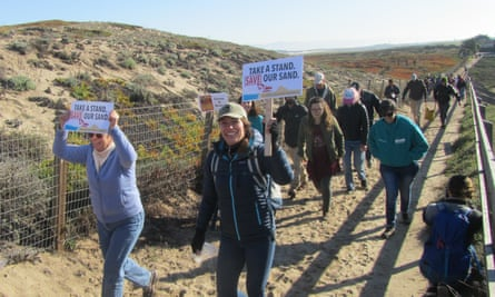 Demonstrators protest against sand mining operations in Marina, California, in January 2017.