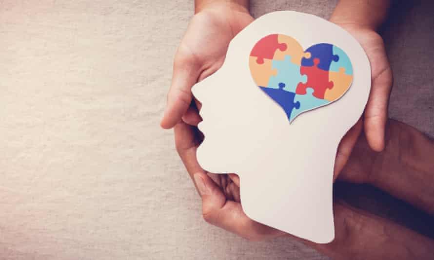 A jigsaw puzzle of a heart shape on the human brain.