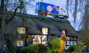a tesco van parked on a thatched roof