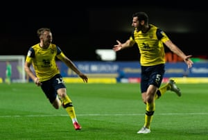 Elliott Moore of Oxford United celebrates his goal with team mate Sam Long.