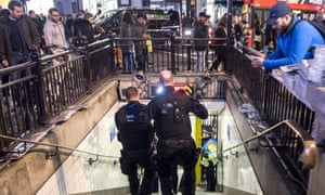 Armed police enter Oxford Circus station on Friday after an incident caused the station to be cleared